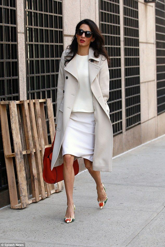 International human rights lawyer Amal Clooney looked summery in a cream outfit with orange accents as she prepares to lecture at Columbia University in New York on Monday
