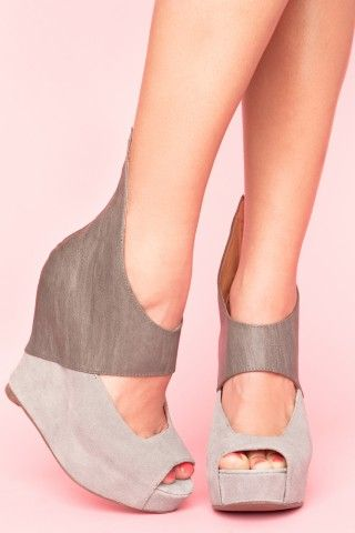Out-of-this-world gray leather and suede peep-toe platform wedges featuring an angular cutout top. Zip closure at back, fully lined leather interior.