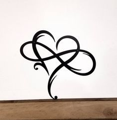 Photo of Metal Heart Infinity Sign