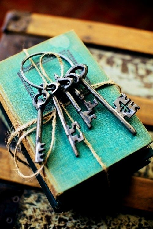 Aged with beauty old book and keys