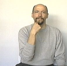 """tell"" American Sign Language (ASL)"
