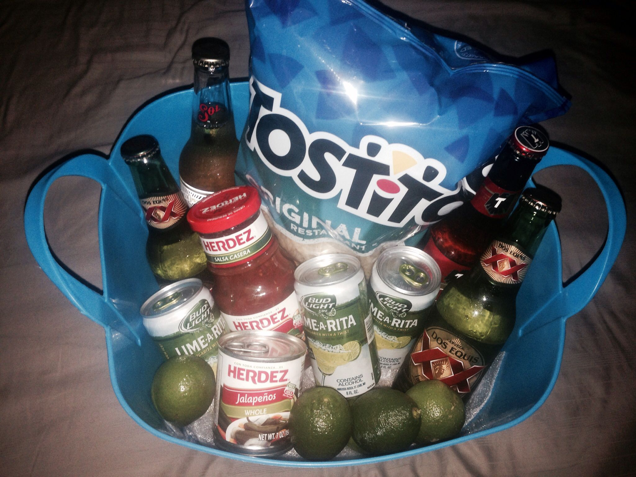 DIY Mexican theme basket I made for my sister. I added some kitchen towels and a few other things but they covered the smaller items, so I took them out for the photo.
