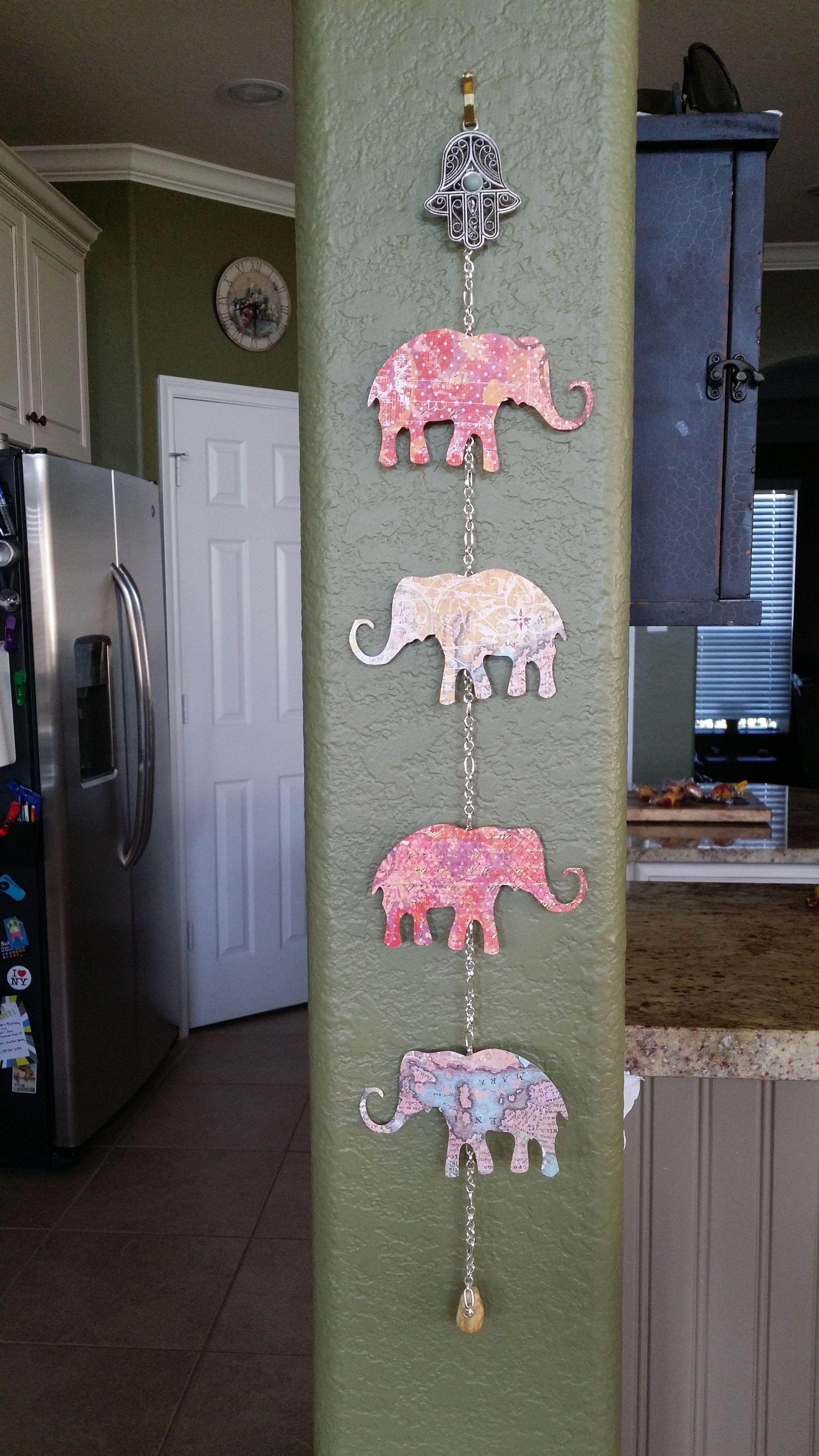 dorm / teen room decor ideas: hanging elephants with silver hamsa