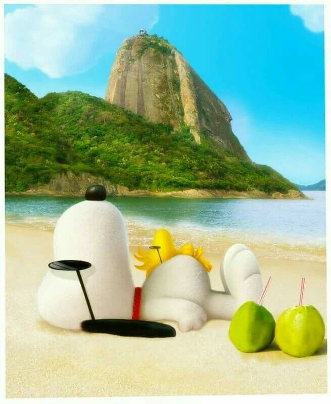 Snoopy and Woodstock Lying in the Sun on a Beach Wearing Sunglasses With Fruit Sitting Nearby