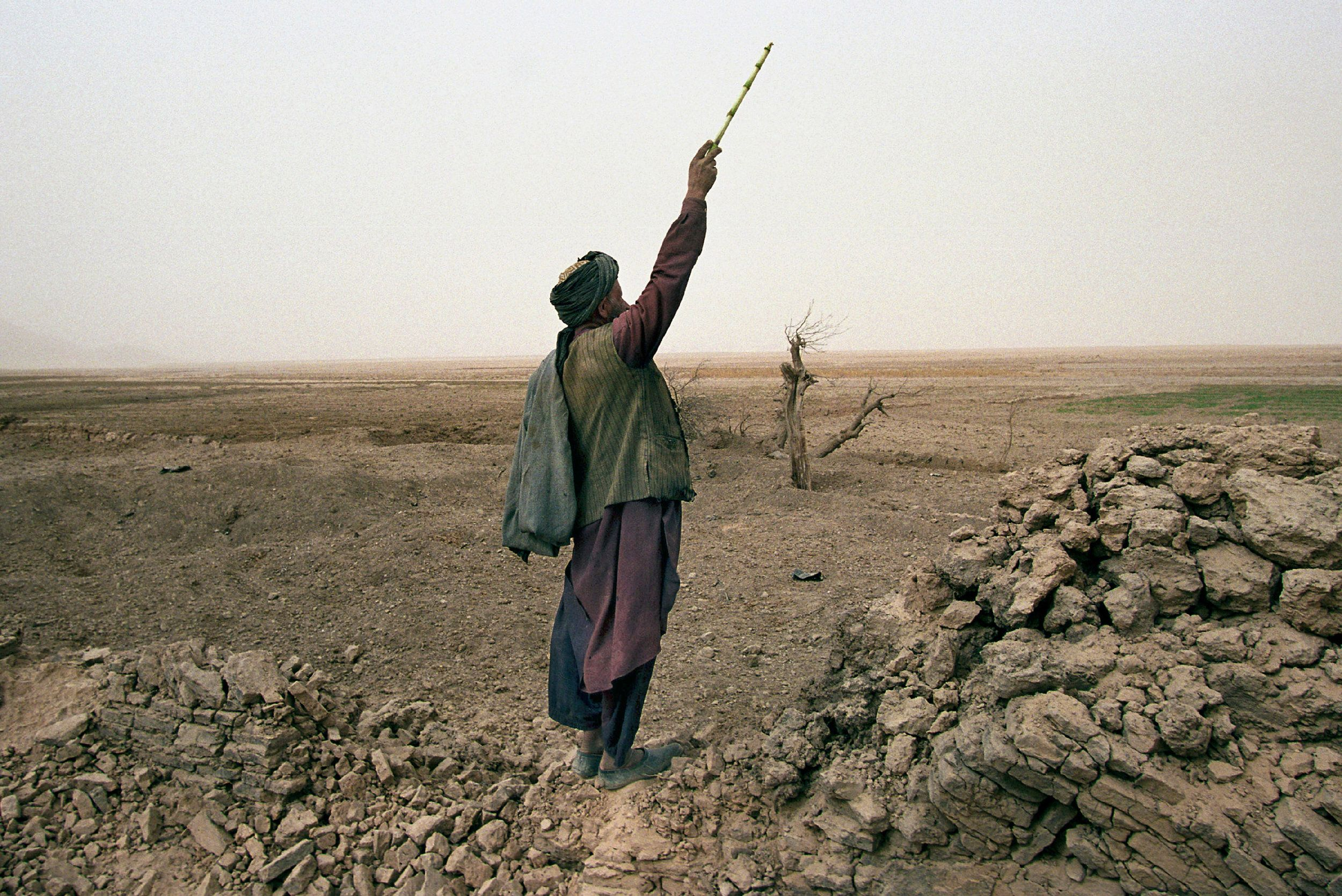 An Afghan shepherd calls to his children in November 2001.