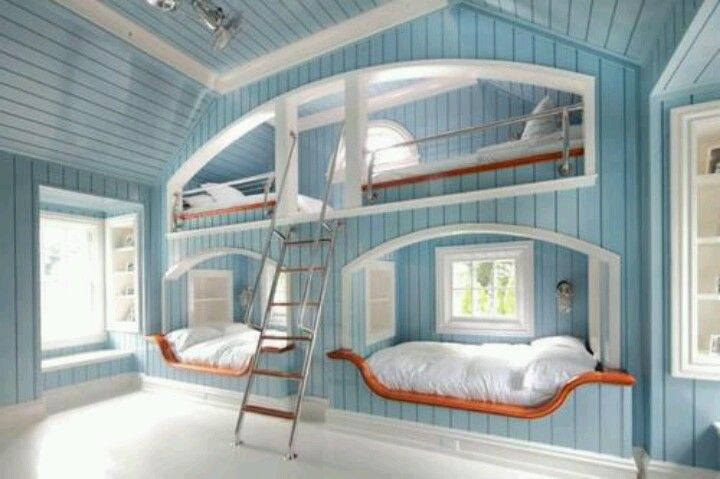 Gives an open space to the rest of the room. Great idea with the shelving by the bed.