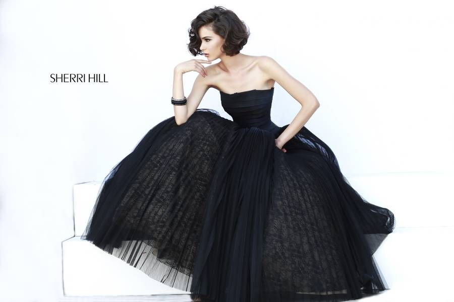 When it comes to ornate elegance, it`s tough to beat this one-of-a-kind Sherri  Hill 32149 creation! Its bandage bodice fits like a glove and culminates in  a