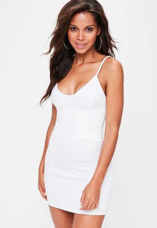 c854d8457945 White bodycon dress featuring an attached corset, silver eyelet and lace up  back, bustier detail and cami straps.