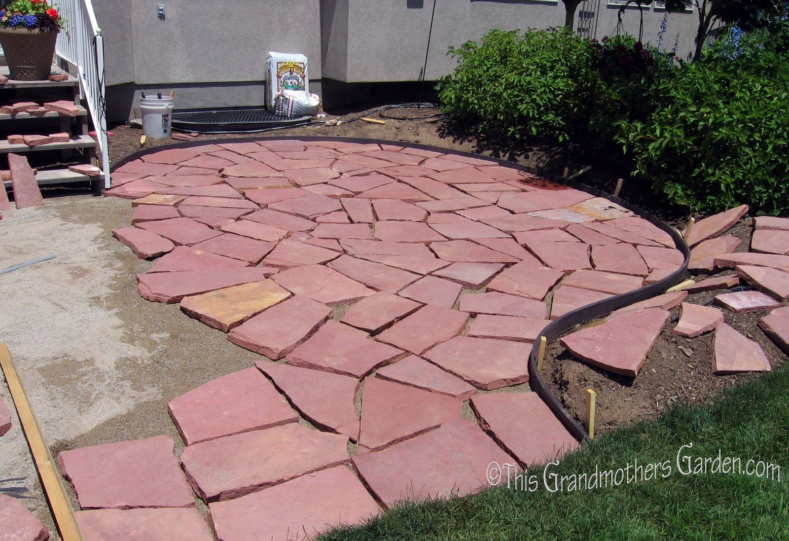 This is the second in a series of how we (as in my Honeyman, a few of my kids and myself) built our beautiful Flagstone Patio .    I've alwa...