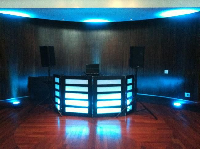 dj facade with cyan blue back lighting and up lighting at the diplomat hotel - Cyan Hotel Decorating