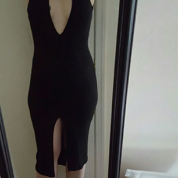 Super Sexy Prada Dress Black deep v-neck Prada dress with tags attached. Fits like a tight medium or small. With tags attached. Feel free to ask for more pictures or make me an offer! Prada Dresses