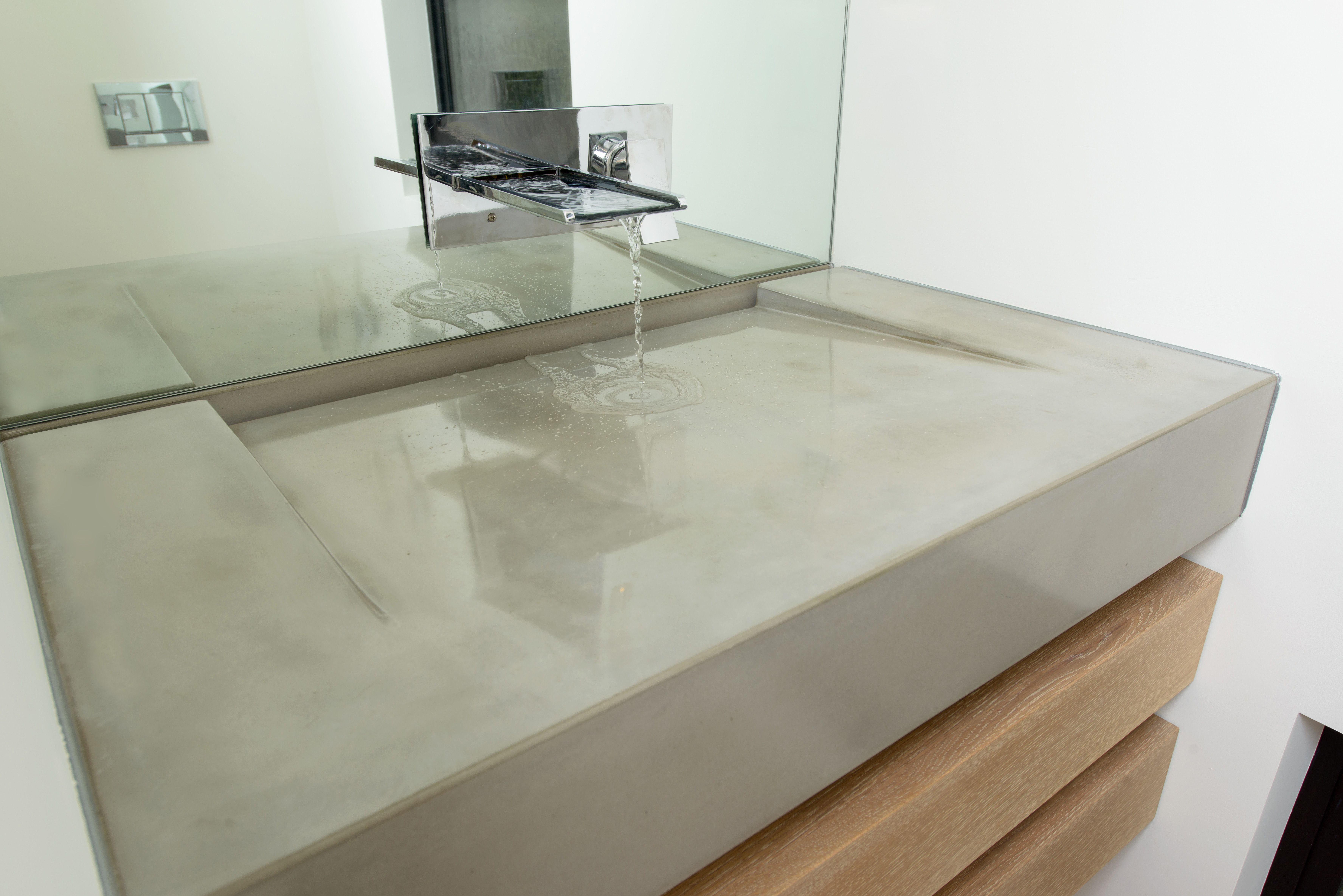 Minimal Slope Concrete Ramp Sink With Negative Edge Slot Drain