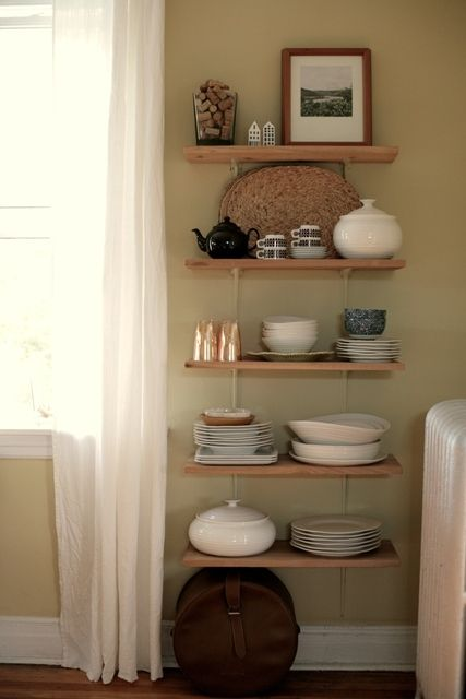 Custom built shelving to display and store housewares. Apartment Therapy.