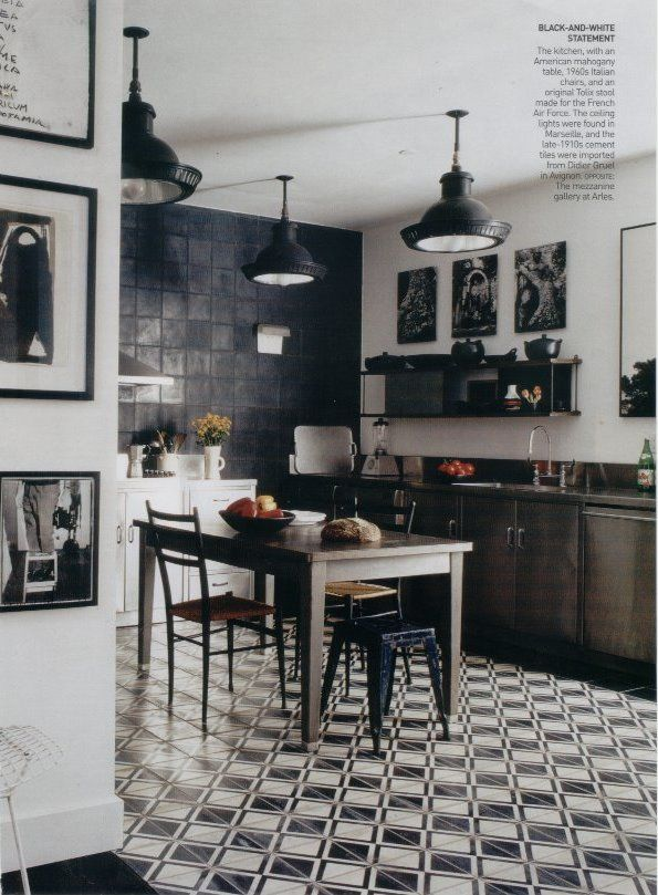 In A Classic Black And White Kitchen An Antique French Cementtile Floor