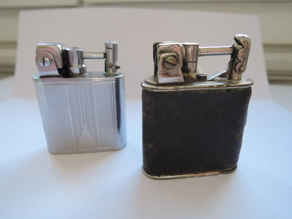 2 briquets vintage LANCEL Petrol lighters. Uncommon. One old Automatic pre-Lancel with external spring, made by Taco-Lite Germany. One late Automatic with internal fuel screw.