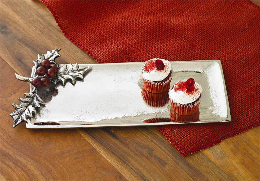 Sand cast aluminum tray is garnished with holly leaves and mango wood berry cluster.