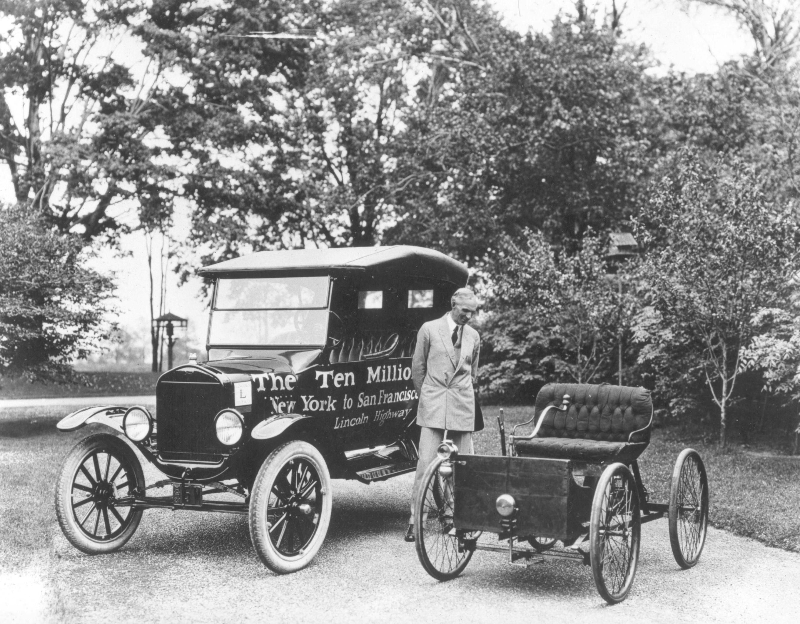 Henry Ford standing next to the first and the ten millionth Model-T ...