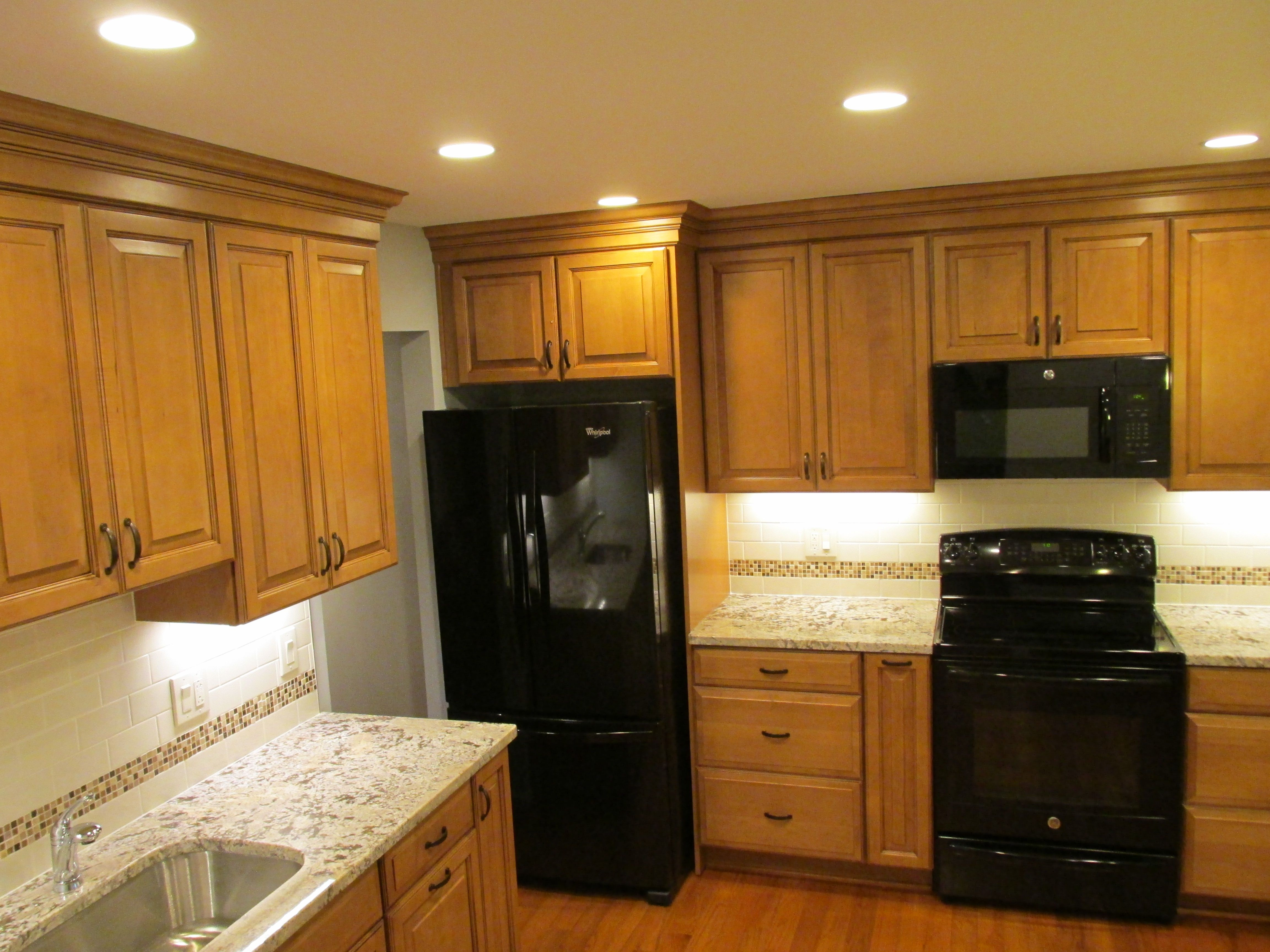 This Is A Complete Remodeling Kitchen With Bruce Manchester Hardwood We Combined Maple Black Appliances Kitchen Kitchen Cabinet Colors Modern Bathroom Design
