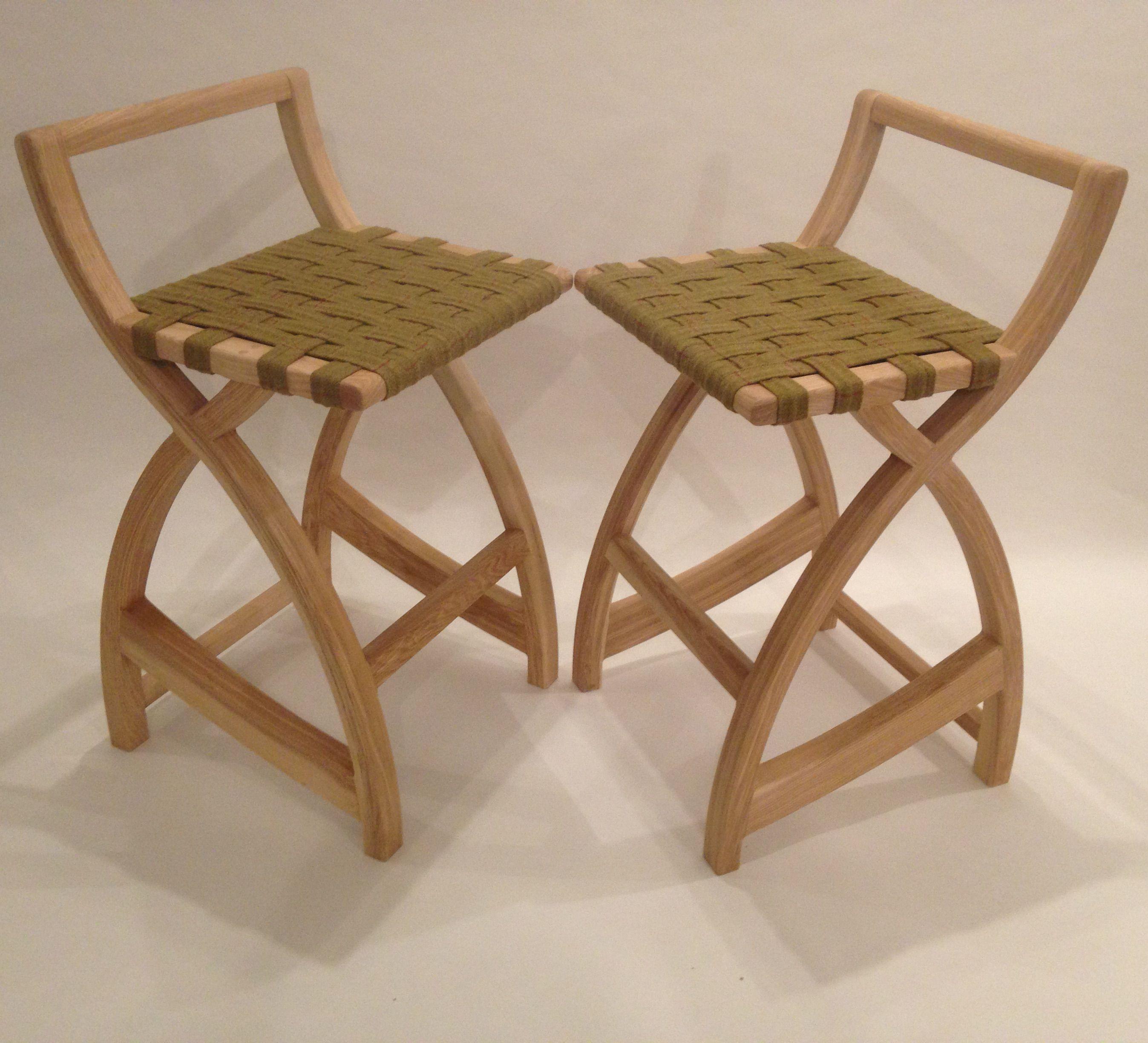 Pair of ash bar stools with woven tweed seats.