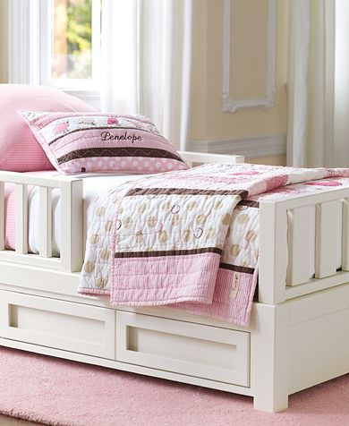 An Adorable White Girls Toddler Bed With Storage Drawers