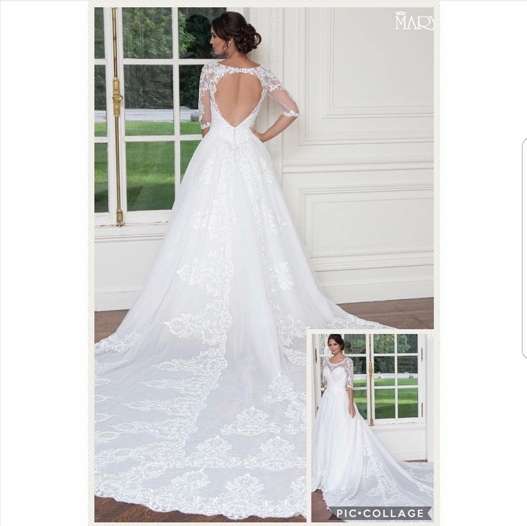 Beautiful wedding gown open back long sleeves with lace appliques