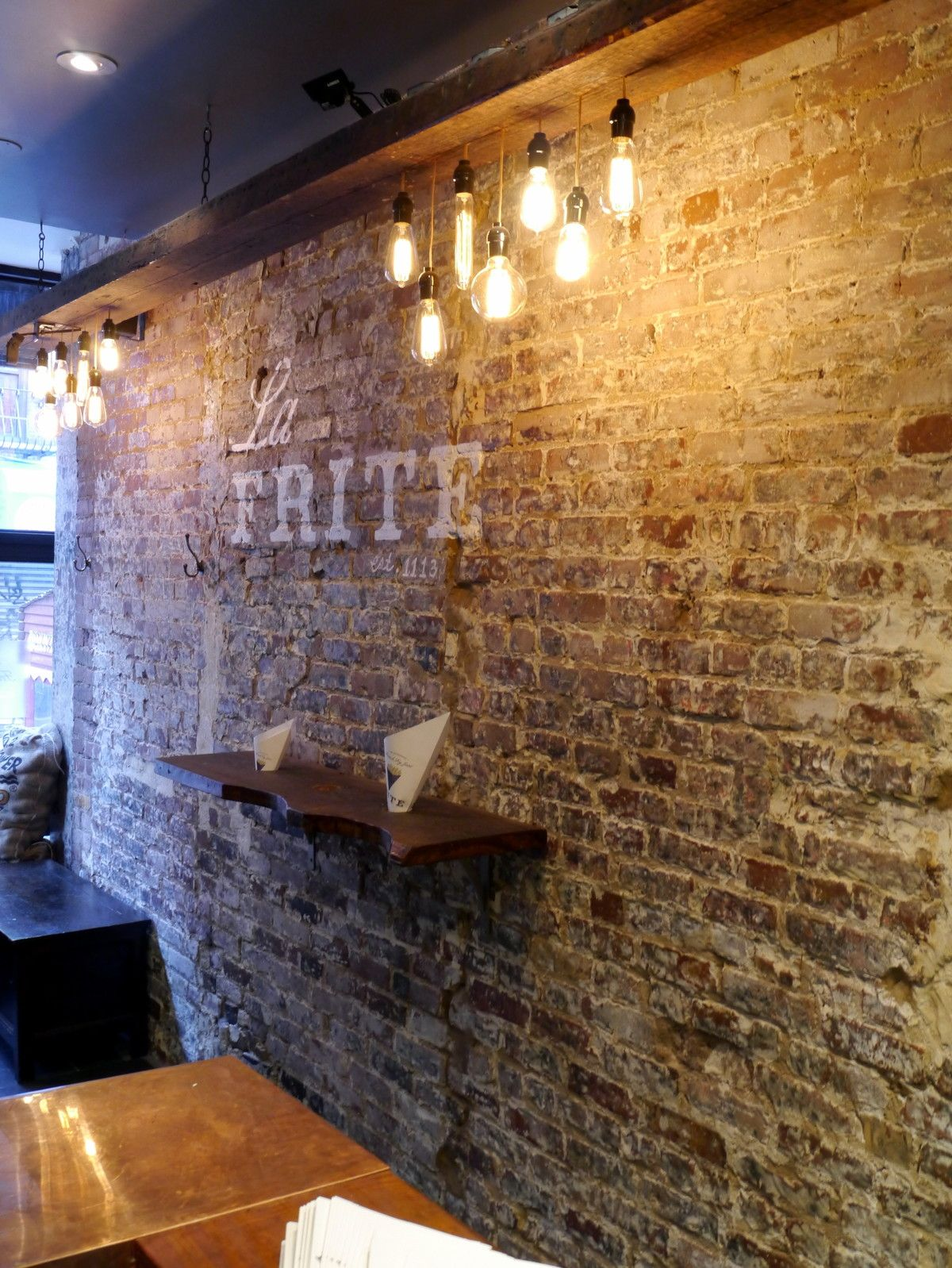 wall restaurant interior design bricks reclaimed wood lighting