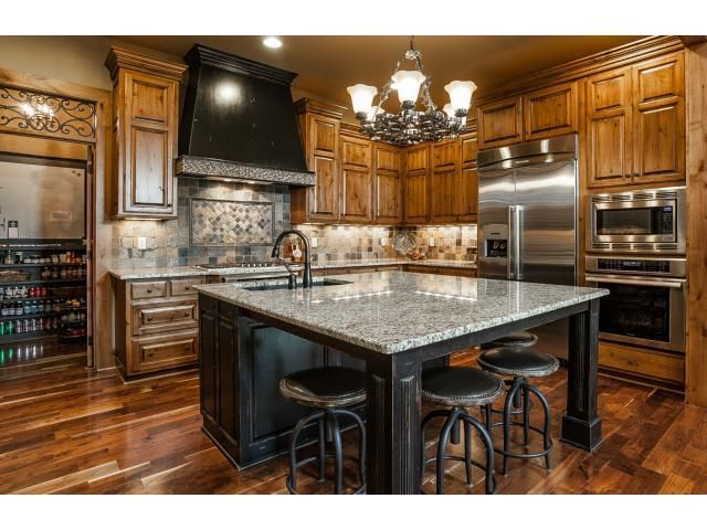 Incredible oversized granite island in this gourmet for Gourmet kitchen islands