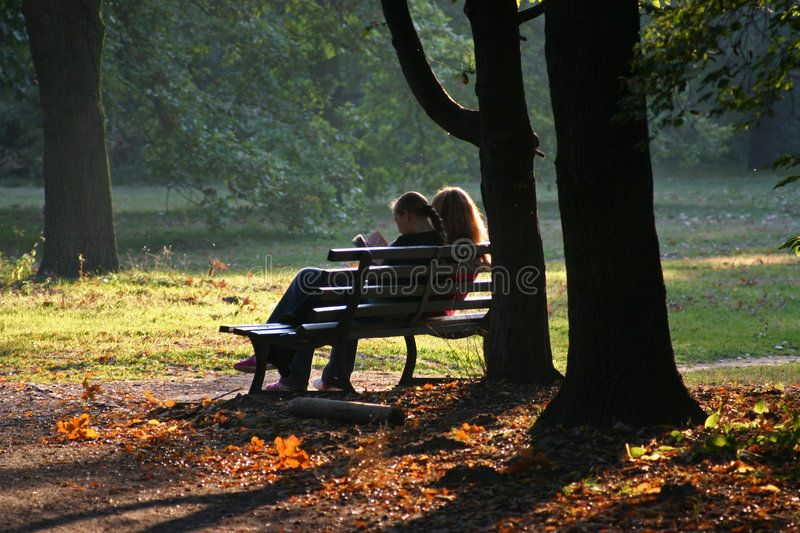 Best Friends Two Girls Sitting On A Bench In A Park In Autumn And Reading A Boo Sponsored Sitting Bench Friends Girls Rea Park Image Stock Photos