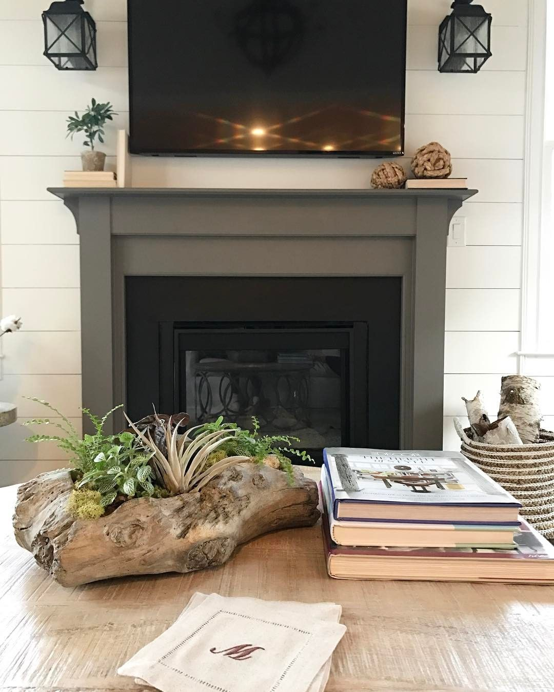 the fireplace surround is painted in sherwin williams gauntlet