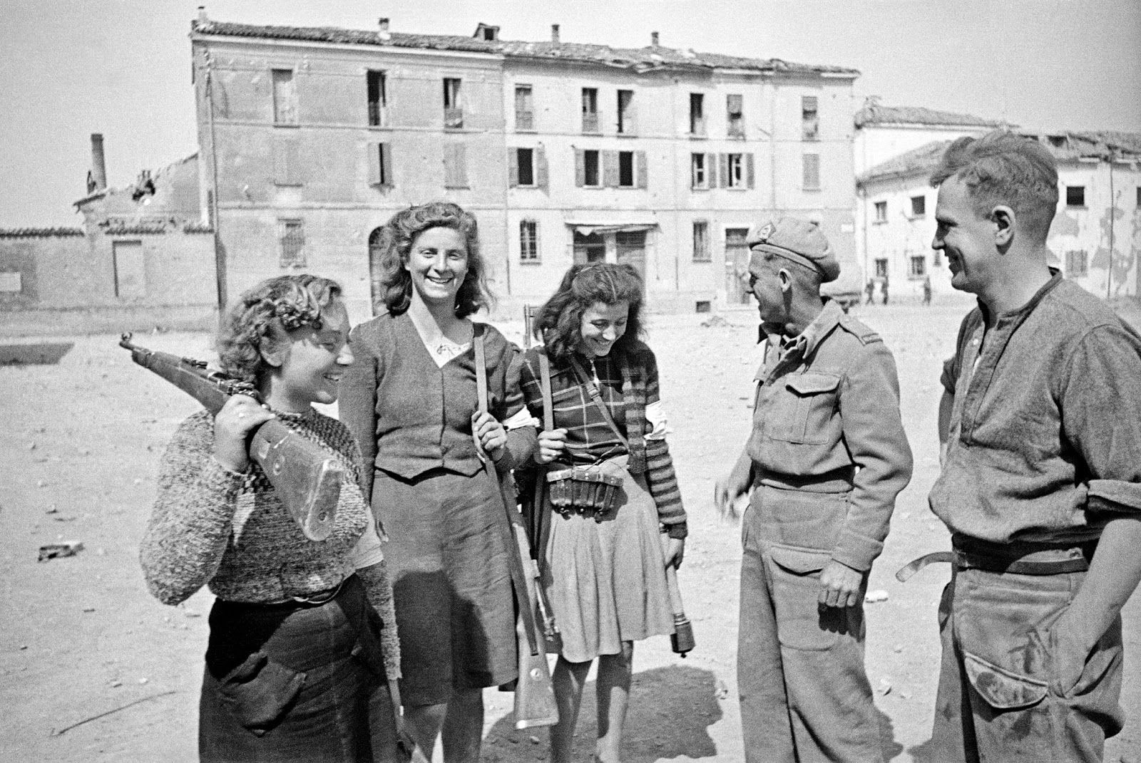 Italian women with rifles and captured German stick grenades  at Massa Lombarda, Italy, during World War II, 13 April 1945