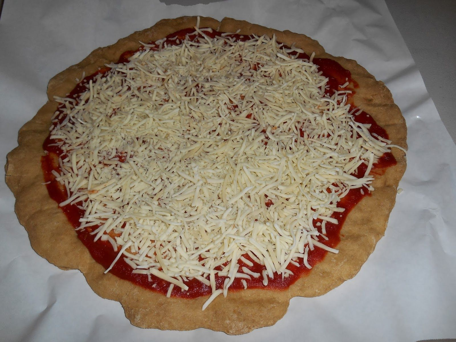 One family living whole wheat pizza crust pizza