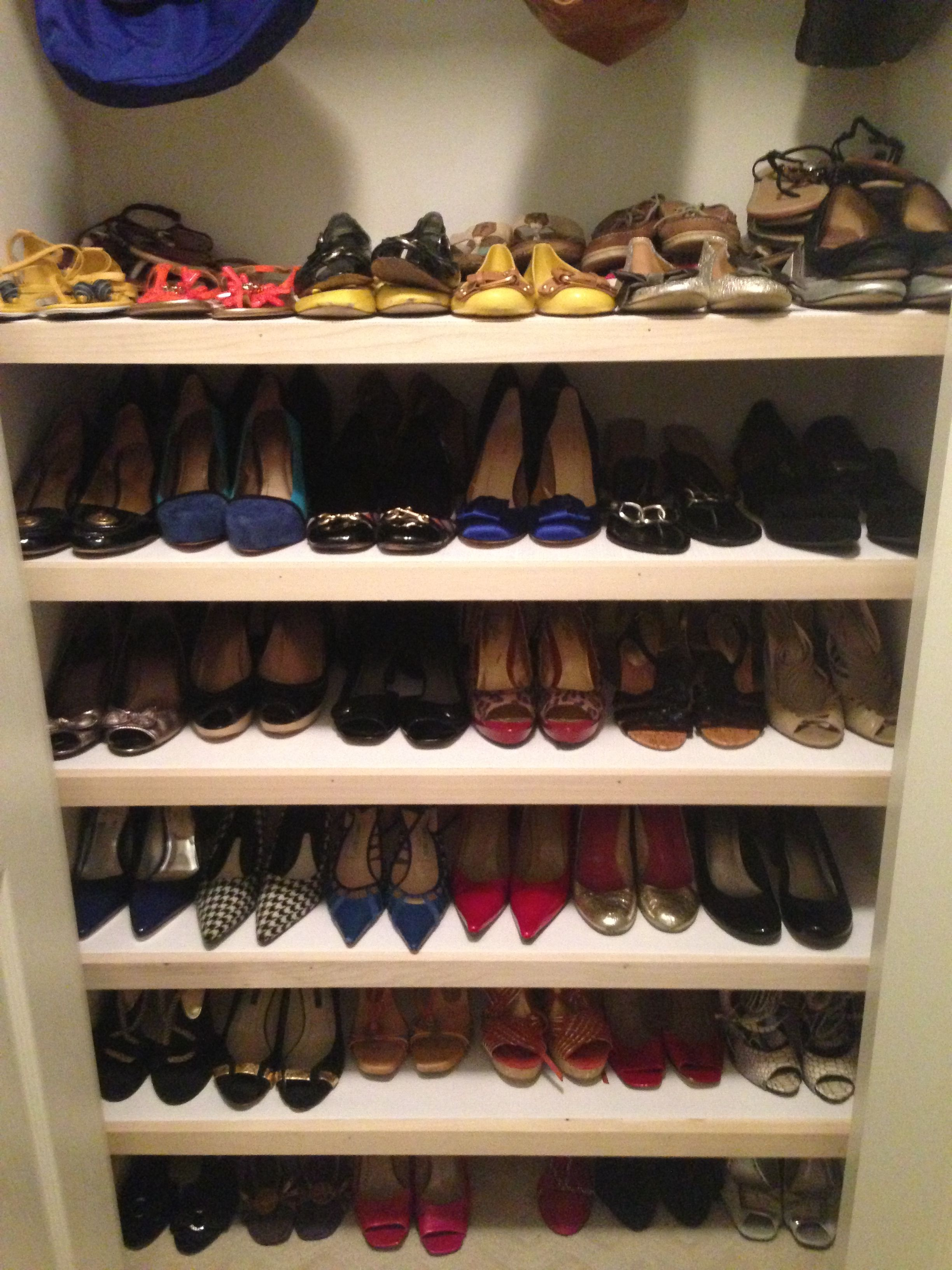 Turn An Extra Bedroom Closet Into An Accessory Closet With Shelves For Shoes And A Raised Bar