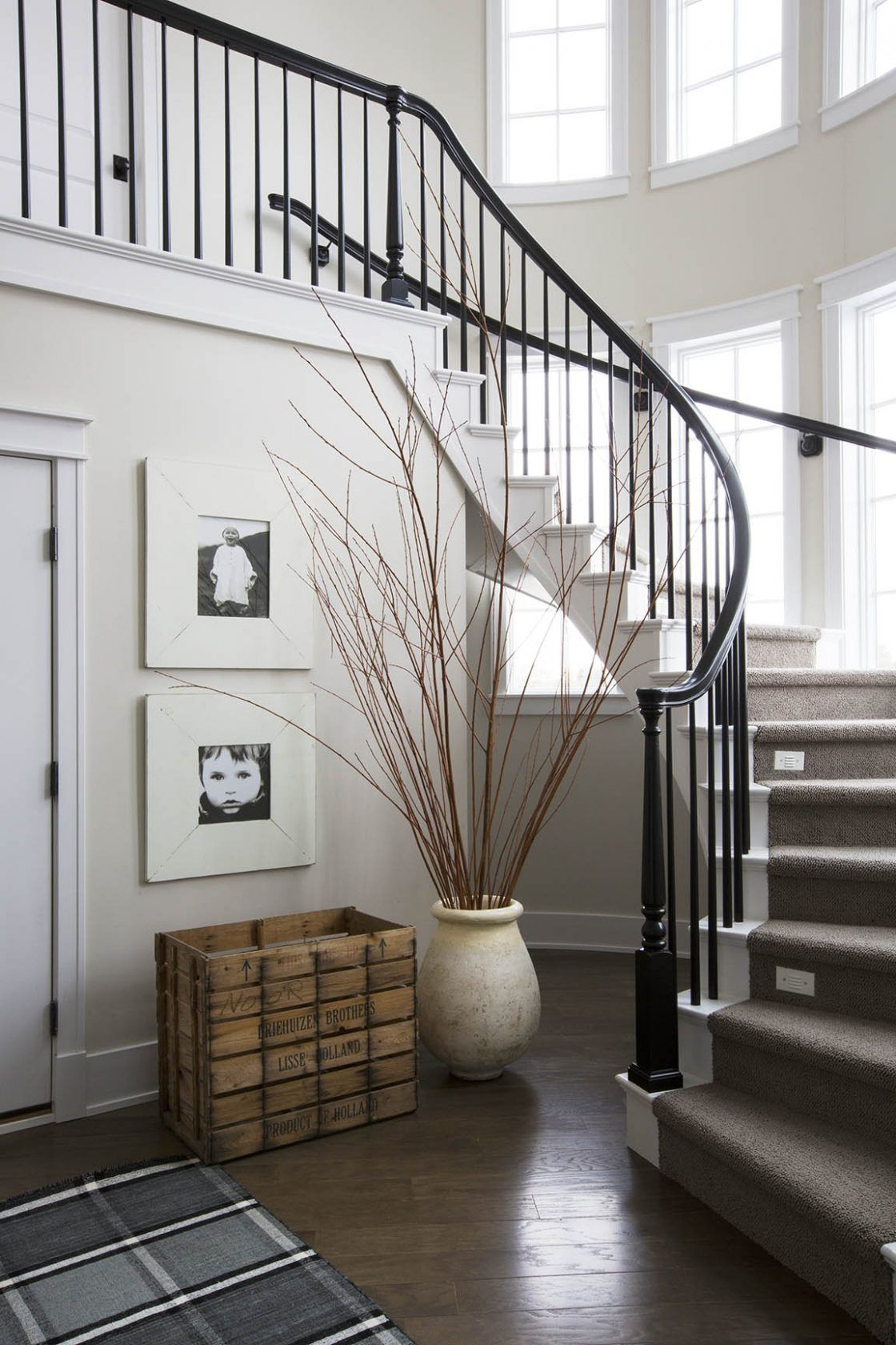 Curved staircase black and white interiors entryways for Curved stair case