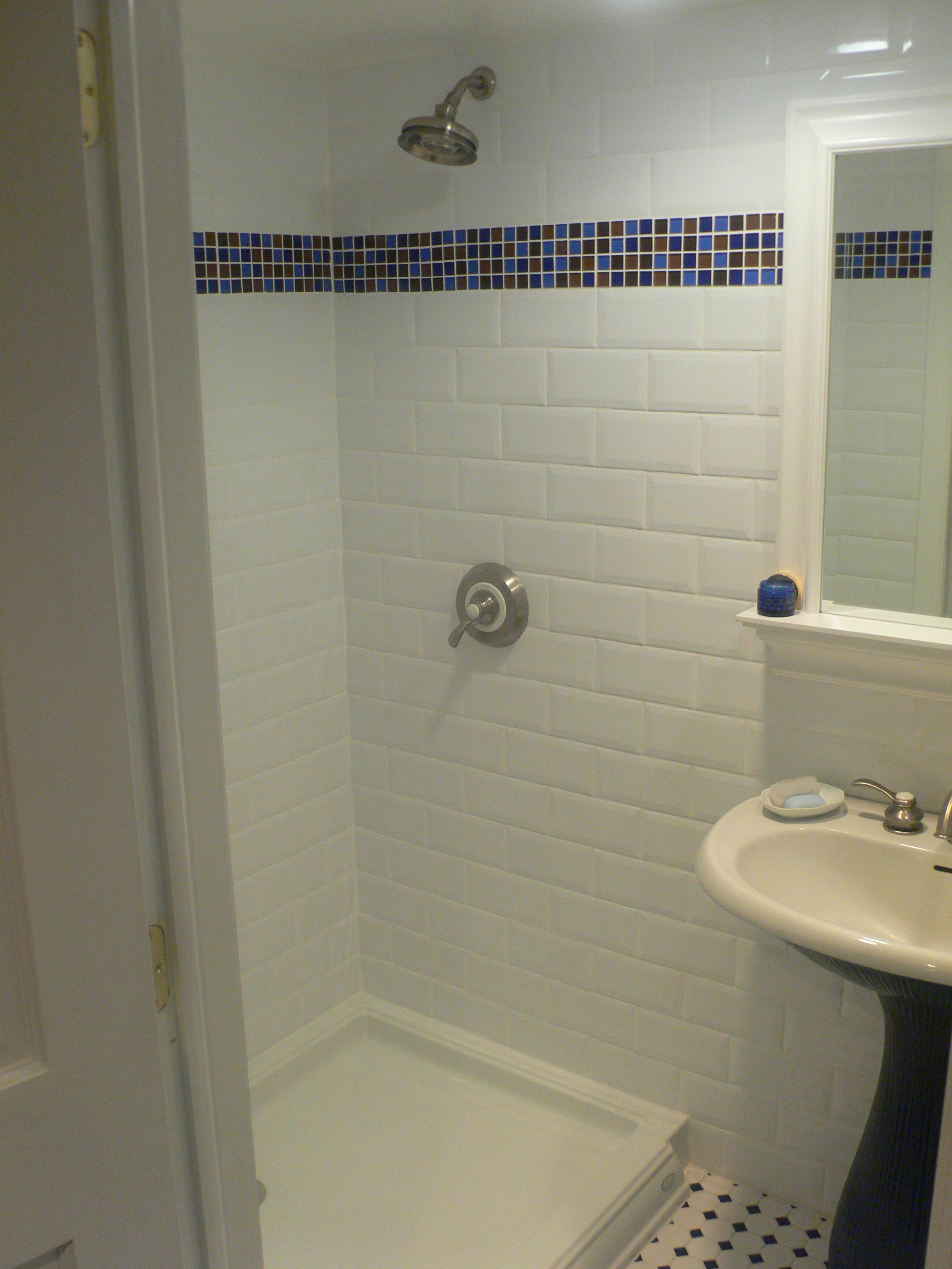 Subway tile in white with glass tile border | bathroom ideas ...