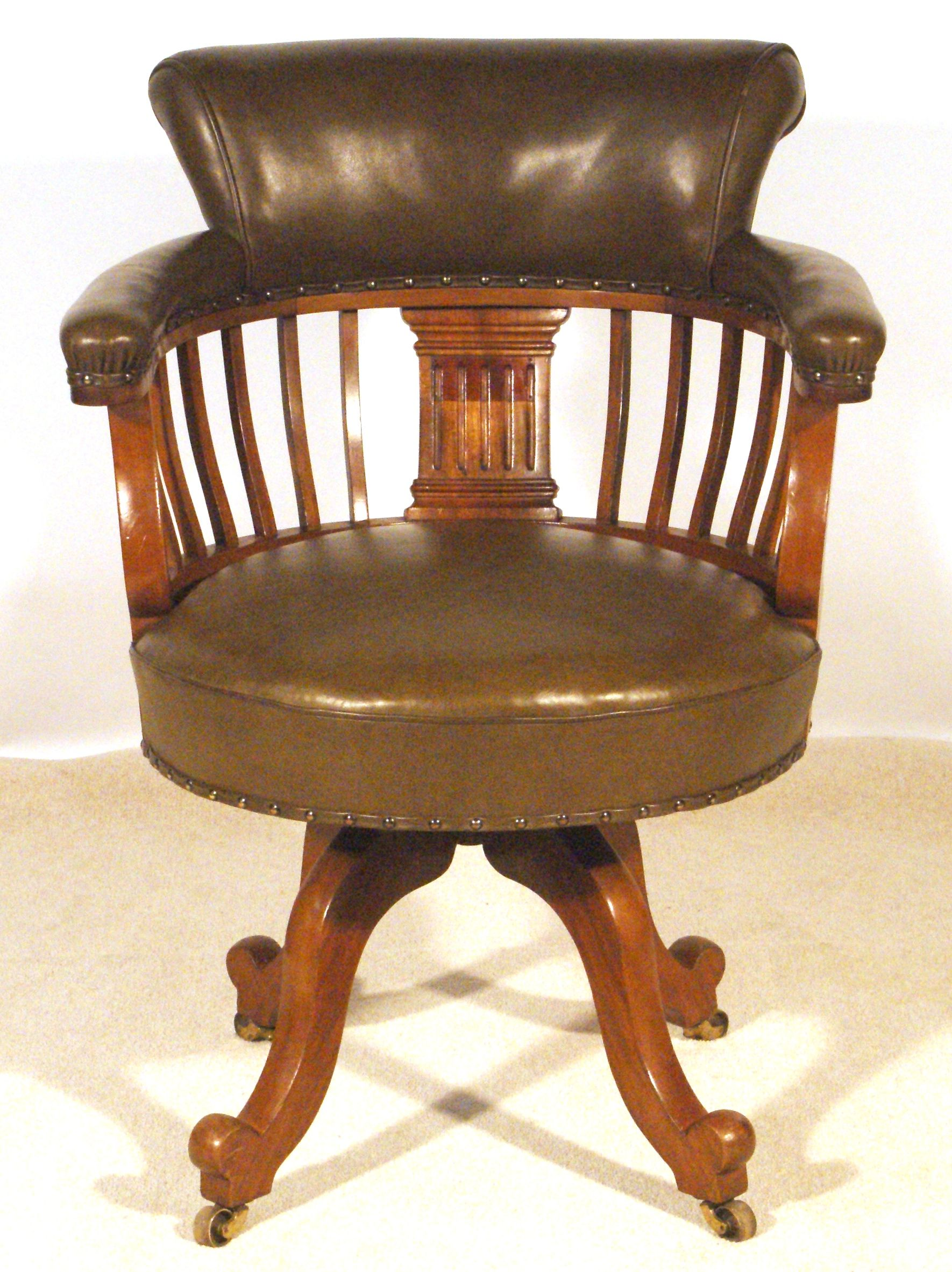 Victorian swivel desk chair well upholstered in new green hide