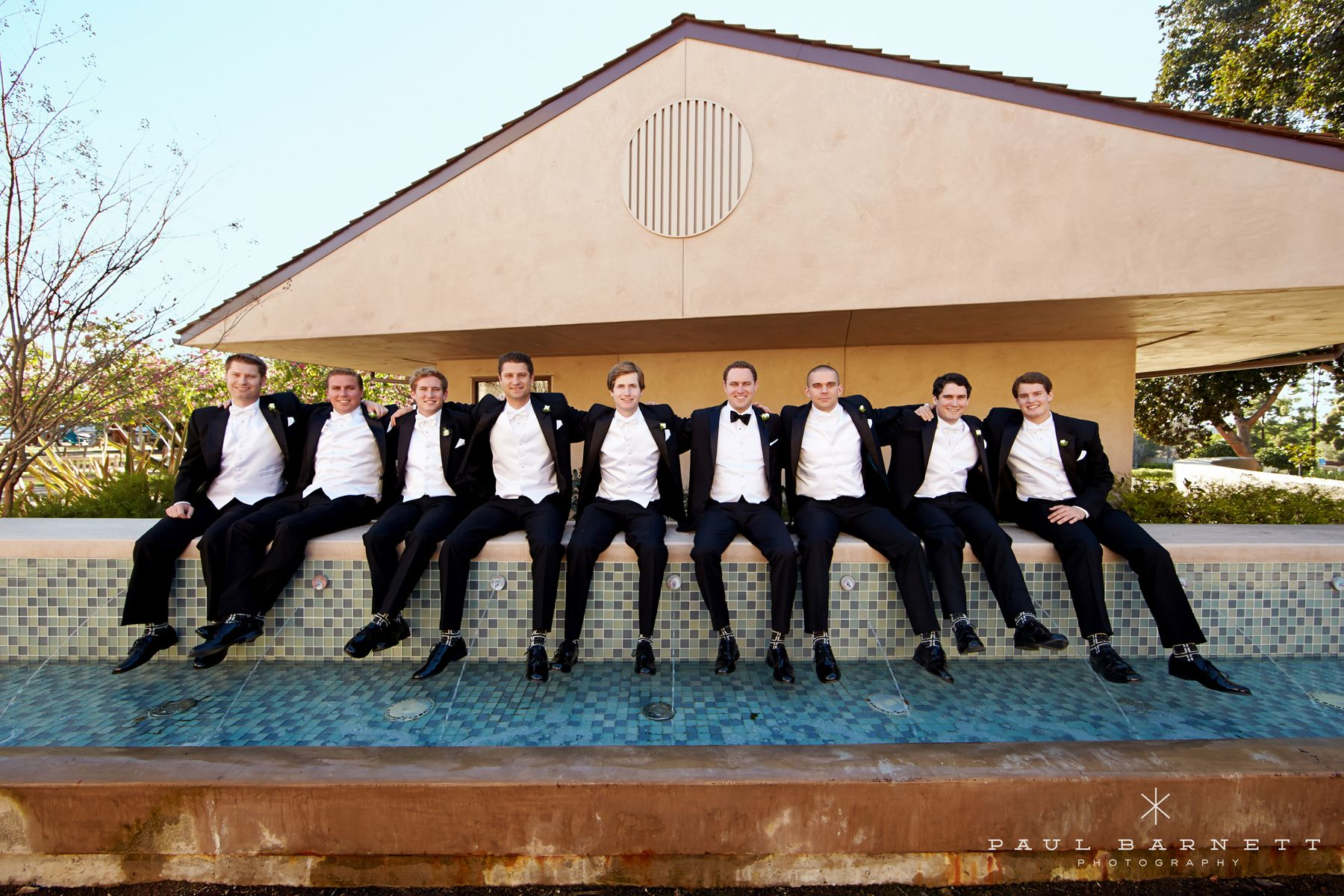 Big parties of groomsmen can make for a lot of fun! Luxury Wedding Photography by photographer Paul Barnett.