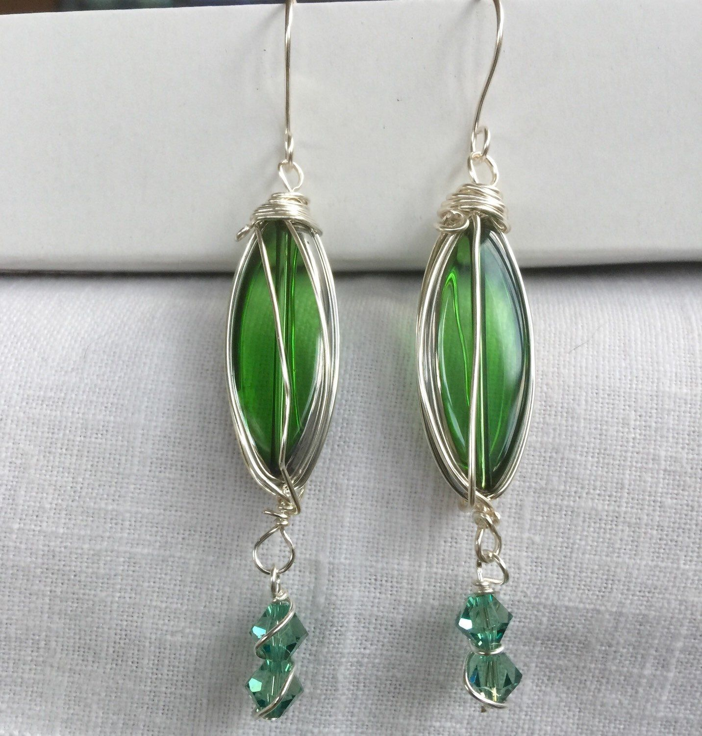 A personal favorite from my Etsy shop https://www.etsy.com/listing/256485237/green-glass-and-swarovski-crystal