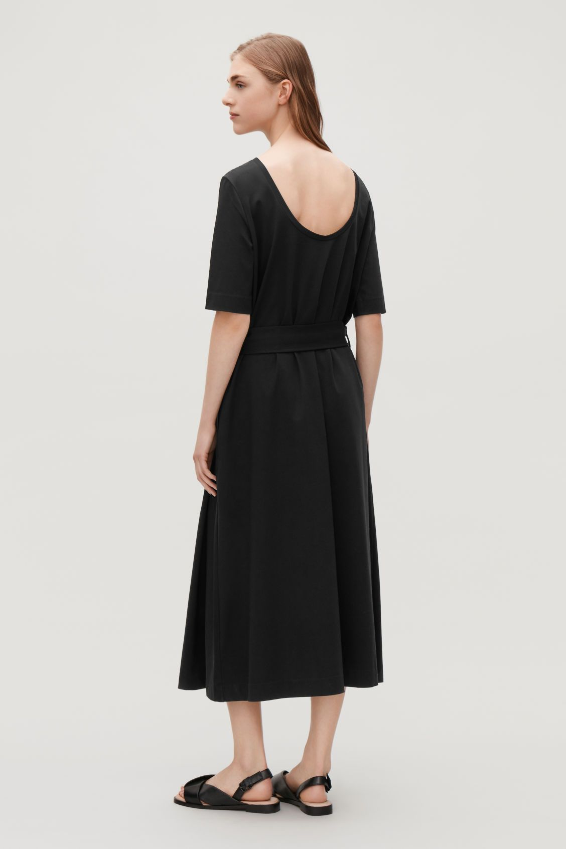 Model side image of cos long aline jersey dress in black fashion