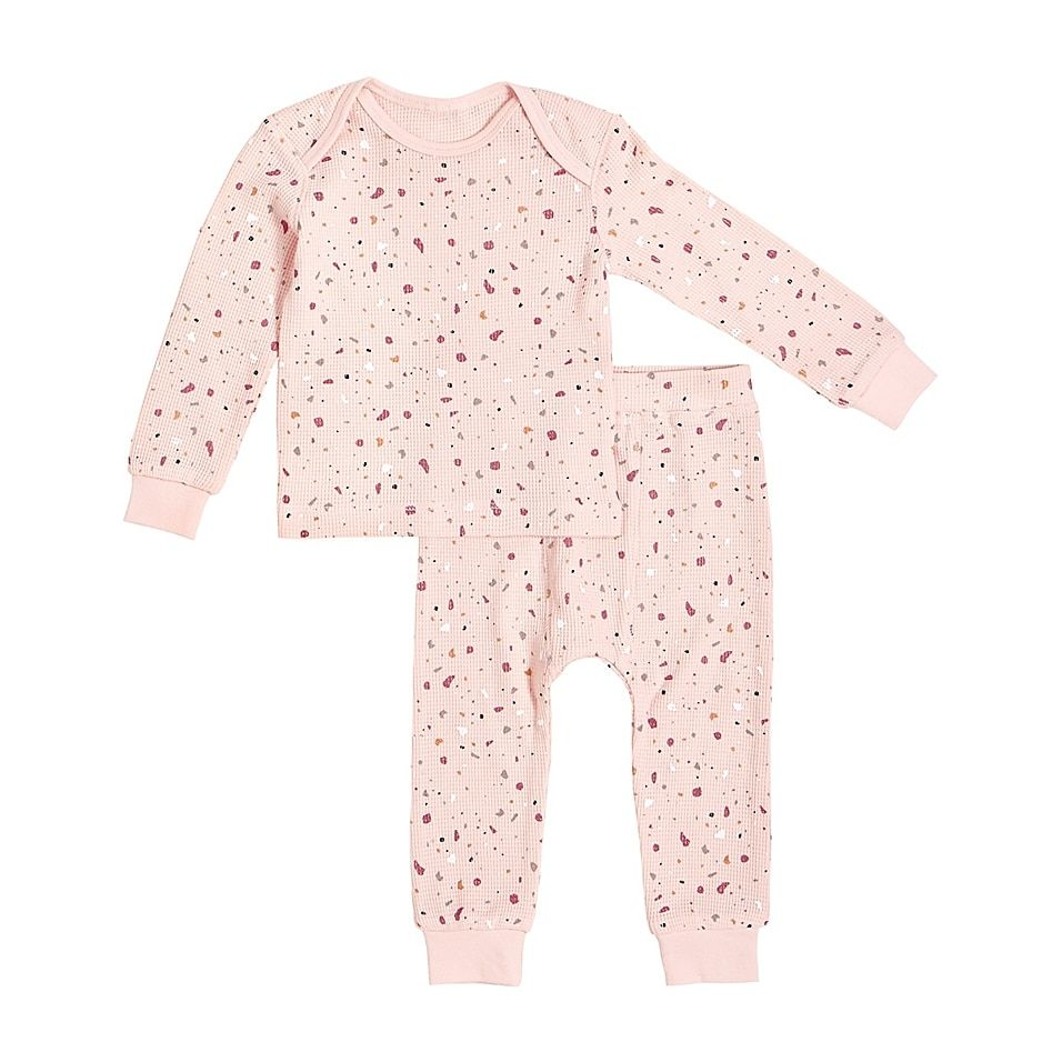 Petit Lem Size 9M 2-Piece Splatter Thermal Pajama Set In Pink - Your little one will be warm and cozy each night with this Petit Lem Splatter Thermal Pajama Set. Cut from snug organic cotton with a sweet splatter design, this shirt and legging pairing provides ultimate comfort for sleep and play.