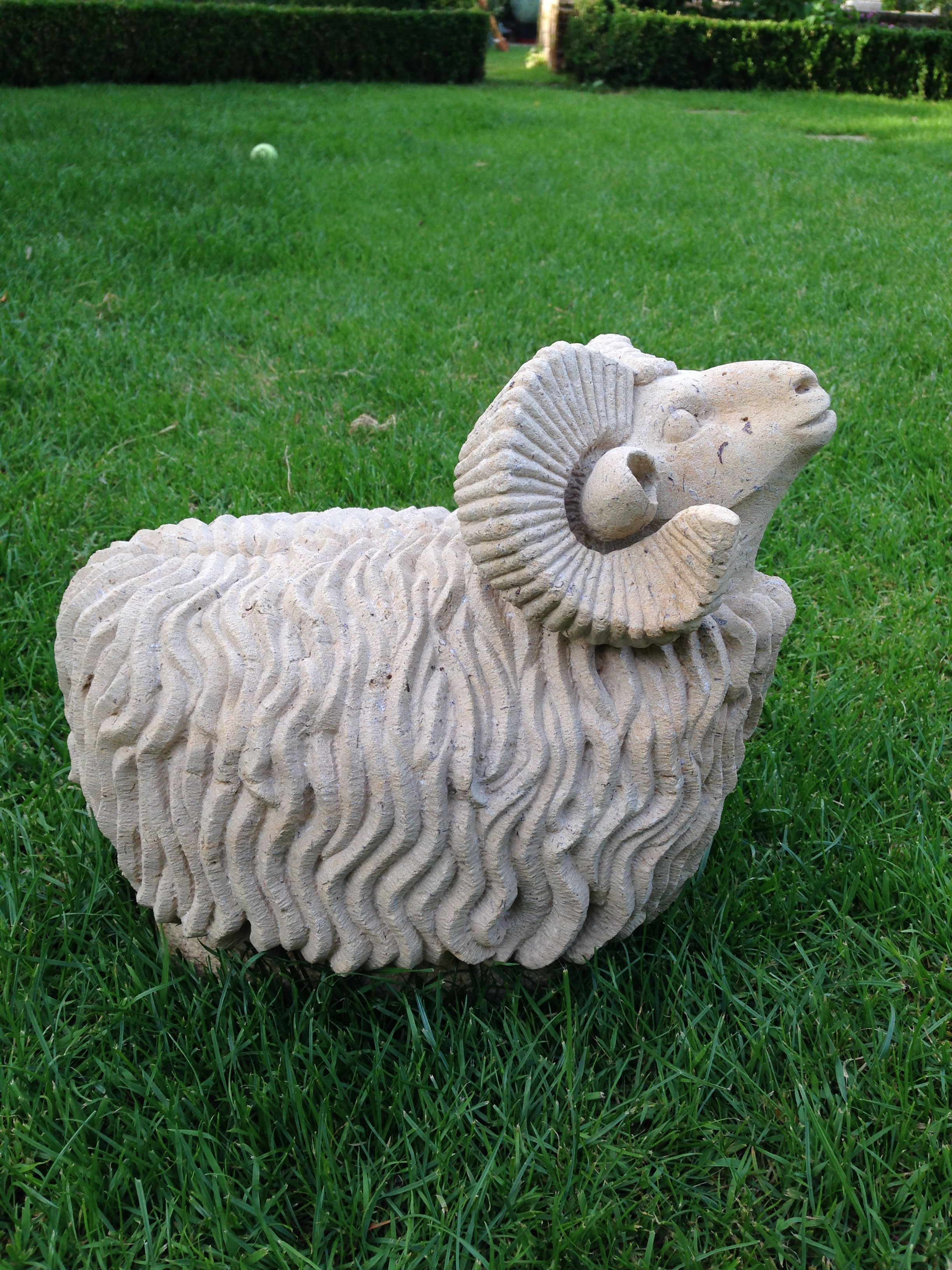 Sheep in stone by Mark McDonnell