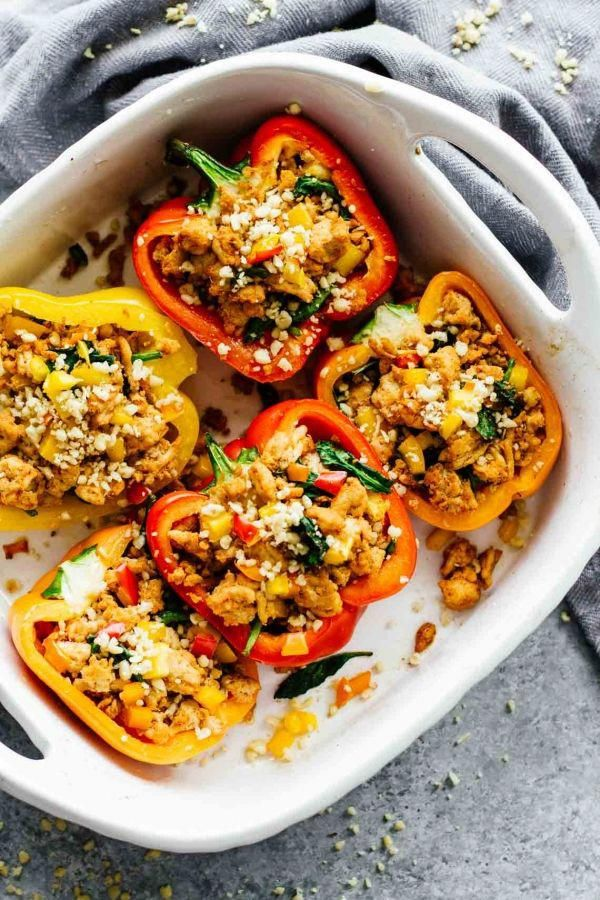 Spicy Southwest Whole30 Stuffed Peppers! These are SO easy to make and perfect for meal prep. Make them in 30 minutes! Also Paleo friendly and gluten free!