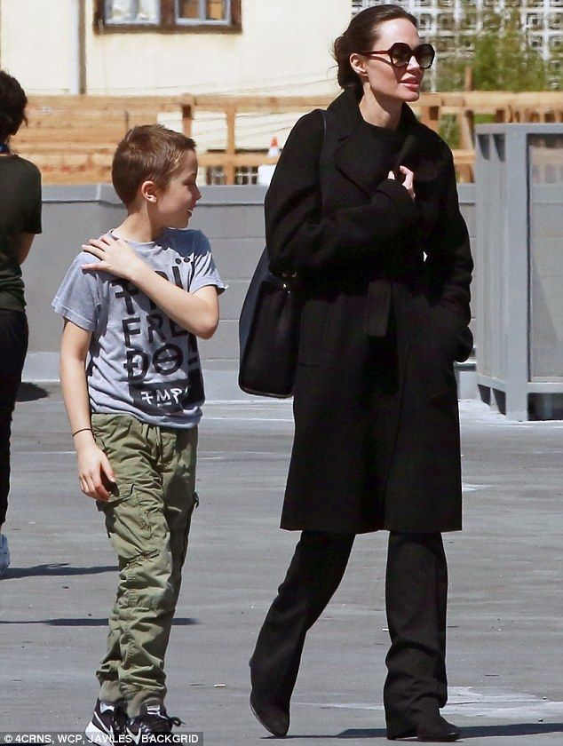 Angelina jolie wears all black ensemble to pet store with son knox busy star angelina also was spotted with knox recently grocery shopping in los angeles ccuart Gallery