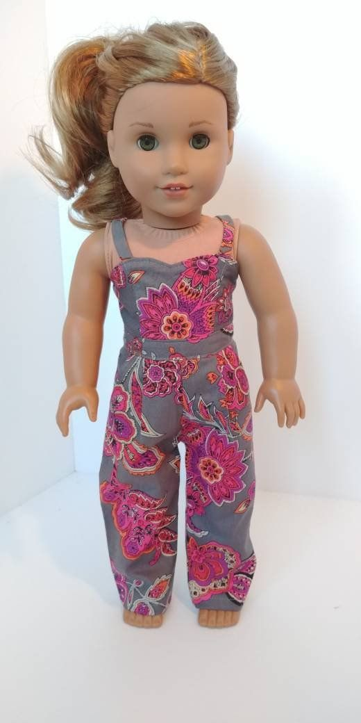 Fits like American girl doll clothes  18 inch doll clothes 18 inch doll clothing  Print jumper is part of Clothes Dresses Girl Dolls - Fits 18 inch dolls  Grey floral jumper with velcro closure and thin straps  Has sweetheart neckline and pleated front  Lined top  Pattern used for jumper is by Liberty Jane  All seams are professionally finished  Jumper only  in the area  Coupon code Localpickup         free shipping Must contact for pick up