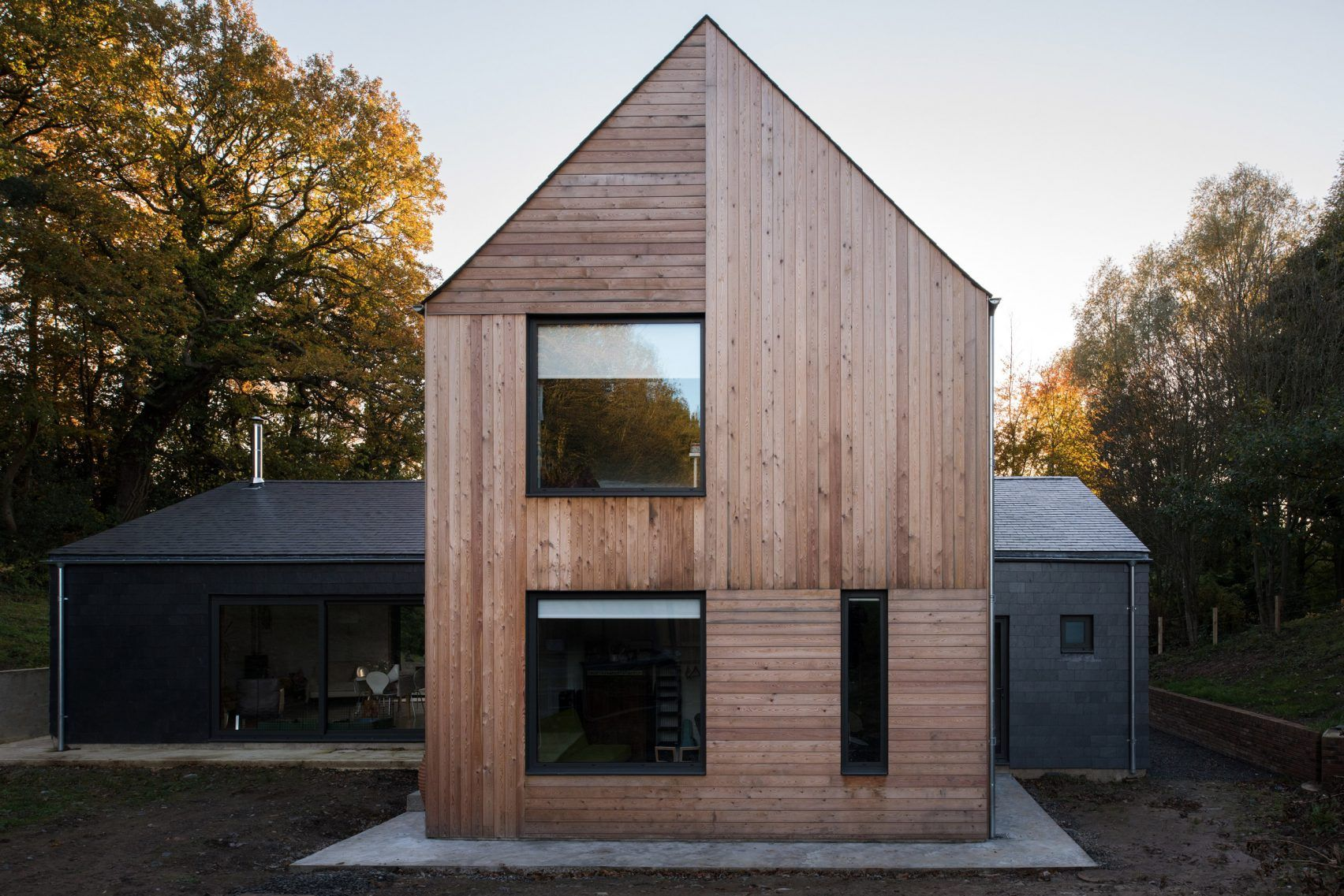 cross shaped house by elliott architects stands in english woodland - Cross Shaped House Plans
