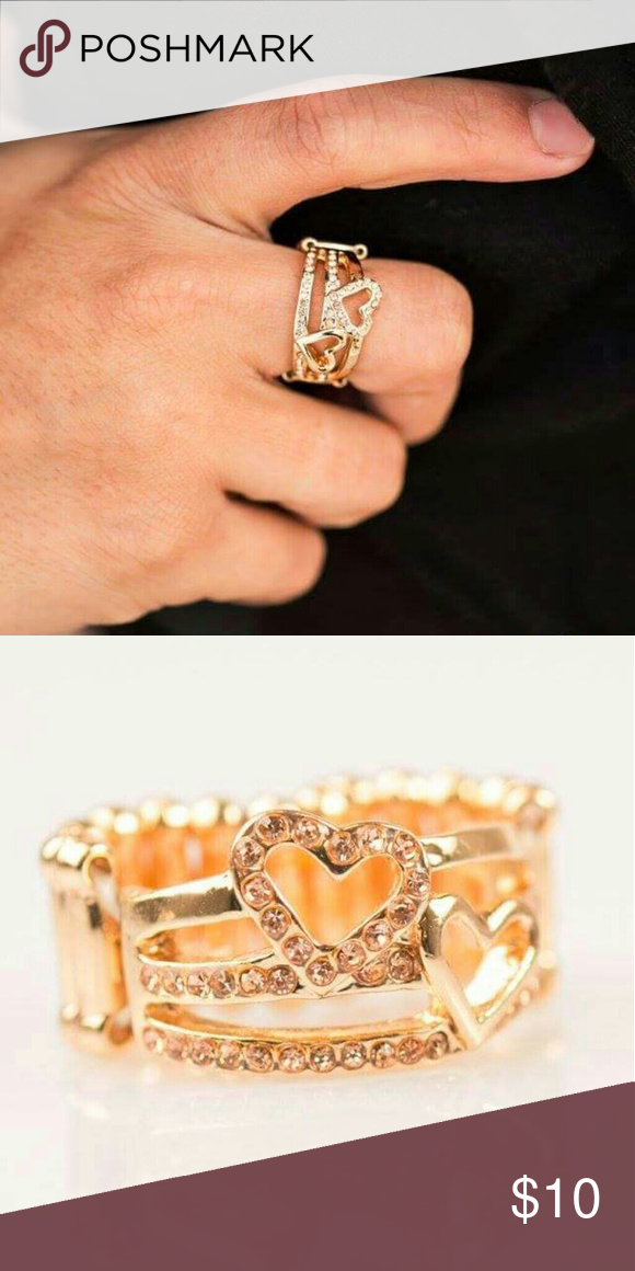 🆕Heart of Gold Ring🆕 Three glistening gold bars arc across the finger, coalescing into an air band. Dusted in glittery peach rhinestones, a sparkling heart and a smooth golden heart embellish the floating bands for a romantic finish. Bottom of the ring stretches for a perfect fit.   *Nickel and Lead Free Jewelry Rings