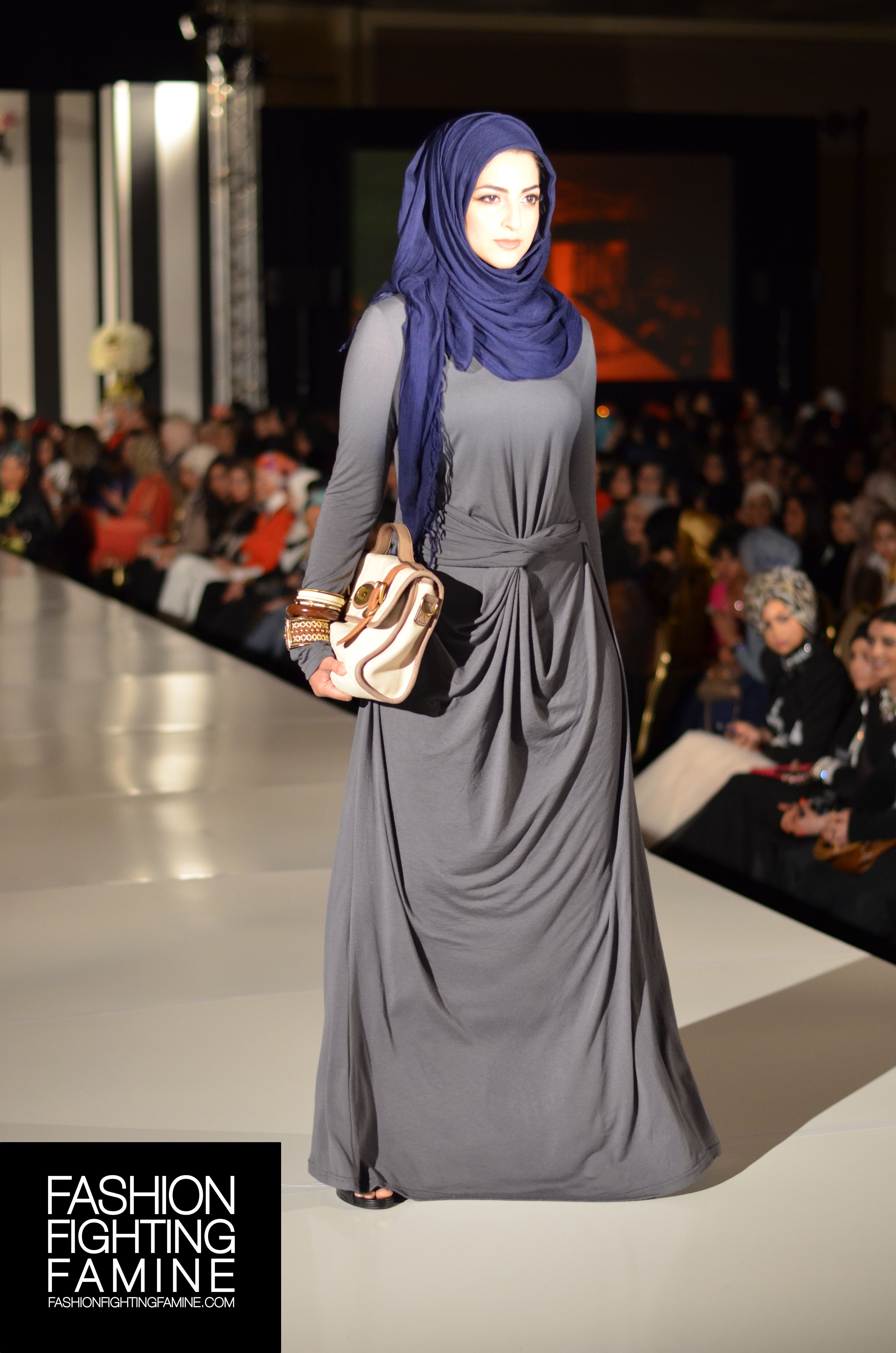 INAYAH on the #FashionFightingFamine 2013 #FFFShow #runway. Styled by Fashion Fighting Famine. #grey #longsleeve #dress