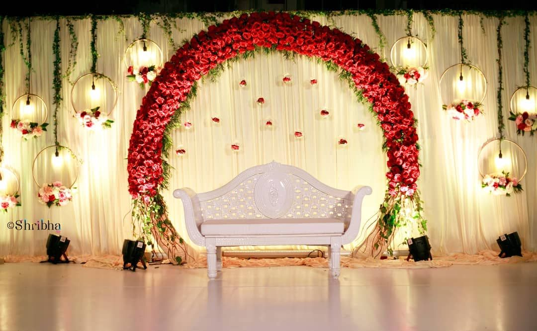 A Red Floral Arch For An Outdoor Wedding Shribha Shribhaweddings Stagedecor Chen Wedding Stage Decorations Wedding Stage Backdrop Wedding Hall Decorations