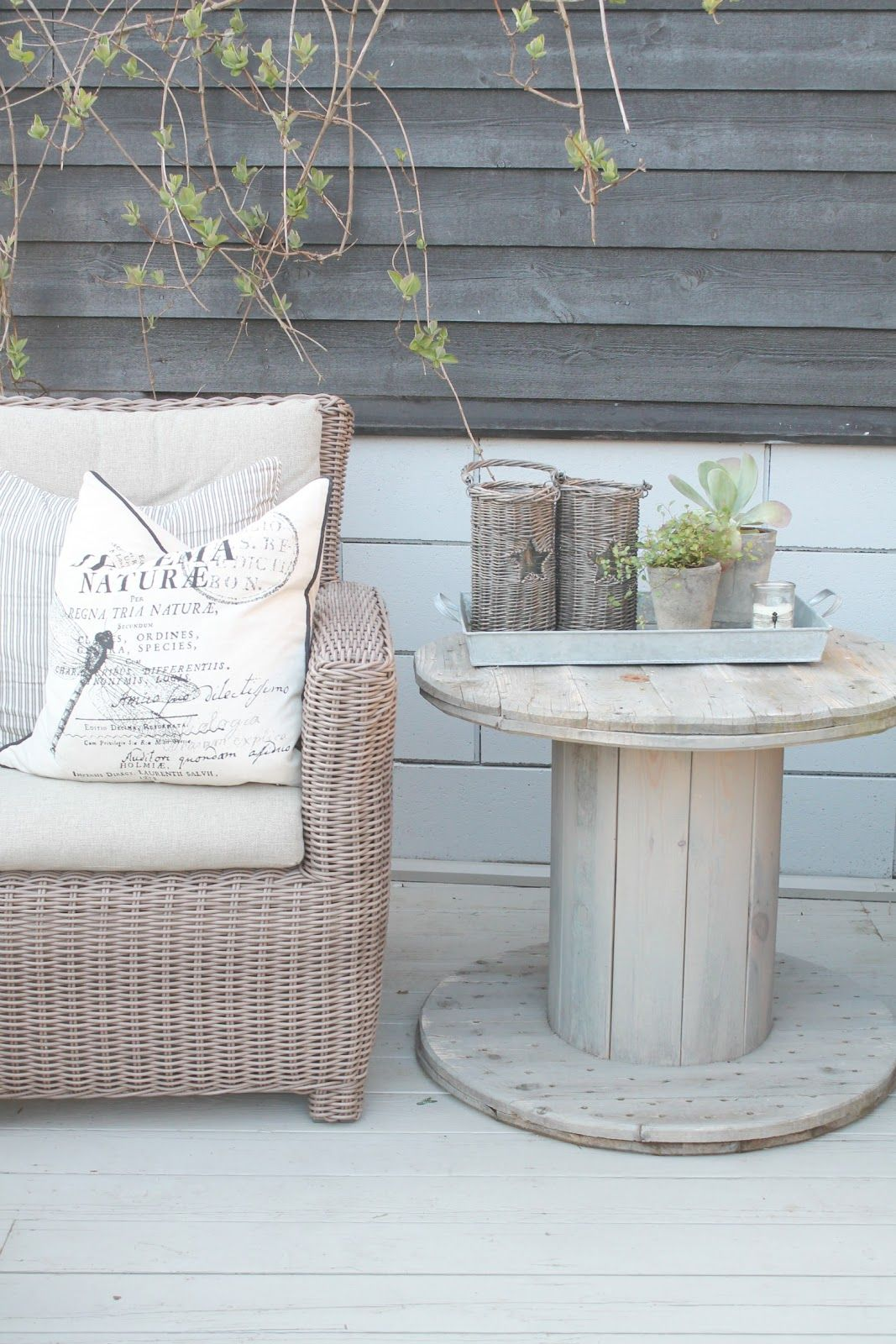 .use Old Wire Spools To Create A Quaint Little Side Table.