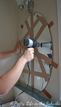 How To Remove A Mirror Glued To The Wall Mirror Makeover Bathroom Mirror Cabinet Bathroom Mirror Makeover