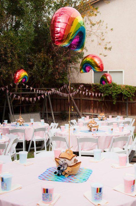 Alternating rainbow and raincloud balloon centerpiece.. maybe a cute idea?